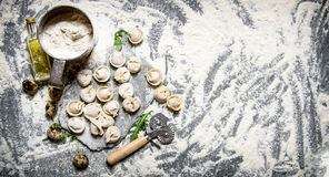 Fresh ravioli with flour and quail egg. On stone table with flour. Free space for text . Top view Royalty Free Stock Photo