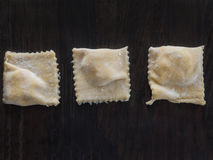 Fresh ravioli with flour on a wooden board. Fresh made ravioli with flour on a wooden board Stock Photos