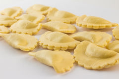 Fresh Ravioli Pasta. Half Moon Shape. Italian Fresh Ravioli Pasta on white background. Half Moon Shape Stock Images