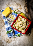 Fresh ravioli stuffed with cheese on the fabric. On rustic background. Top view Royalty Free Stock Photo