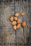 Fresh raw almonds. On a wooden background Royalty Free Stock Images