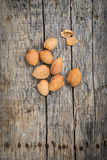 Fresh raw almonds. On a wooden background Royalty Free Stock Photography