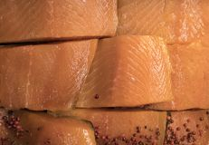 Fresh raw appetizing pieces of salmon with cowberries. On the storefront in the hypermarket Stock Photos