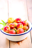 Fresh raw apricots. In a bowl Stock Photos