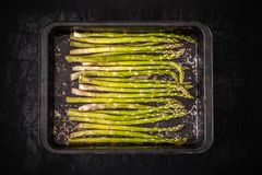 Fresh raw asparagus. In cooking pan Royalty Free Stock Images