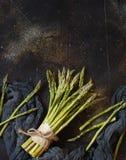 Fresh raw asparagus spears. On a dark table royalty free stock photos