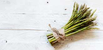 Fresh raw asparagus spears. On a white table royalty free stock image