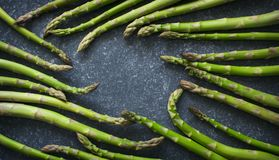 Fresh  raw asparagus on stone background. Copy space Royalty Free Stock Photography