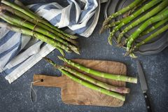 Fresh  raw asparagus on stone background. Top view Stock Photography