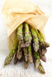 Fresh raw asparagus. On white wooden table Stock Images