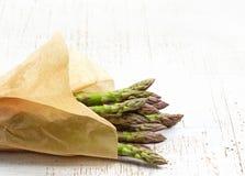 Fresh raw asparagus. On white wooden table Stock Photos