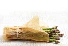 Fresh raw asparagus. On white wooden table Royalty Free Stock Photos