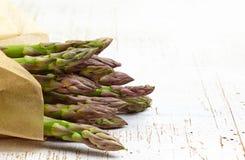 Fresh raw asparagus. On white wooden table Stock Photo