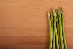 Fresh raw asparagus. On wooden background Royalty Free Stock Photo