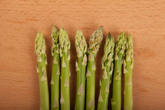 Fresh raw asparagus. On wooden background Royalty Free Stock Images