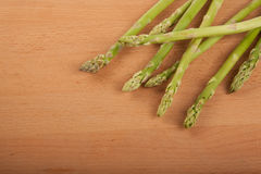 Fresh raw asparagus. On wooden background Stock Photos