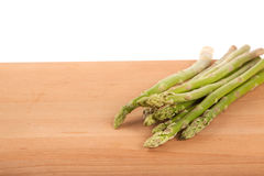 Fresh raw asparagus. On wooden background Stock Image