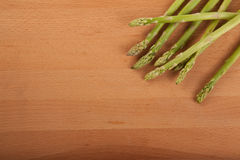 Fresh raw asparagus. On wooden background Stock Photography