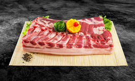 Fresh and raw bacon ribs on kitchen table ready for bbq or grill with clipping path.  Stock Photos