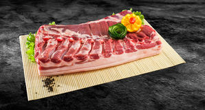 Fresh and raw bacon ribs on kitchen table ready for bbq or grill. With clipping path Stock Images