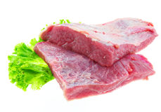 Fresh Raw Beef. And salad on white Stock Images