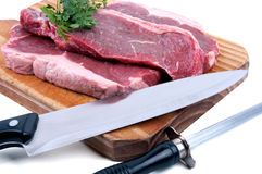 Fresh raw beef. On wooden cutting board Royalty Free Stock Photos