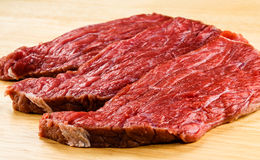 Fresh raw beef. Fresh beef and vegetables on wooden cutting board Royalty Free Stock Photo