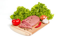 Fresh raw beef on board. With vegetables Stock Photo
