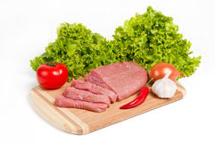 Fresh raw beef on board. With vegetables Stock Image