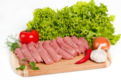Fresh raw beef on board. With vegetables Royalty Free Stock Photos