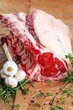 Fresh Raw Beef bone rib roughly choppid. with herbs. Royalty Free Stock Photo