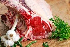 Fresh Raw Beef bone rib roughly choppid. with herbs. Royalty Free Stock Photography
