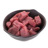Fresh raw beef cubes in black bowl isolated on white background.  Royalty Free Stock Image