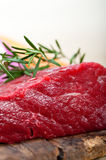Fresh raw beef cut ready to cook. With vegetables and herbs Royalty Free Stock Photos