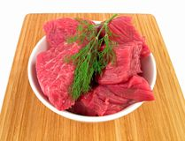 Fresh raw beef on cutting board. (isolated on white background Royalty Free Stock Images