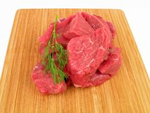Fresh raw beef on a cutting board. (isolated on white background Stock Images
