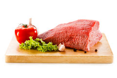 Fresh raw beef on cutting board. Fresh beef and vegetables on white background Royalty Free Stock Photography