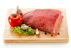 Fresh raw beef on cutting board. Fresh beef and vegetables on white background Stock Image