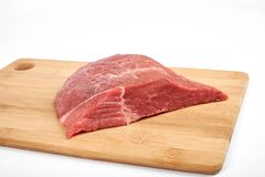 Fresh raw beef on a cutting board isolated on white background.  Stock Photos