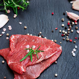 Fresh raw beef. From the farmers market on a black grunge table. Selective focus, copy space background Stock Image