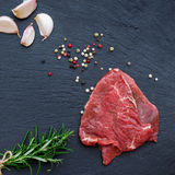 Fresh raw beef. From the farmers market on a black grunge table. Selective focus, flat lay Stock Image