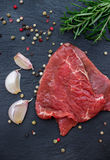 Fresh raw beef. From the farmers market on a black grunge table. Selective focus, flat lay Royalty Free Stock Photo