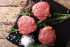 Fresh raw beef filet mignon with spices cut ready to cook close Stock Photos