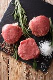 Fresh raw beef filet mignon with spices cut ready to cook close Royalty Free Stock Image
