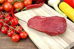 Fresh Raw Beef Fillet Loin Steak And Vegetables. On Wood Cutting Board Background Royalty Free Stock Photography