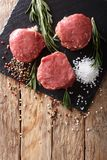 Fresh raw beef fillet mignon on old wooden background. Vertical. Fresh raw beef fillet mignon on old wooden background close up. Vertical top view from above Stock Photo