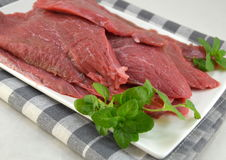 Fresh raw beef fillet. On a white plate Royalty Free Stock Image