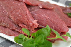 Fresh raw beef fillet. On a white plate Stock Photo