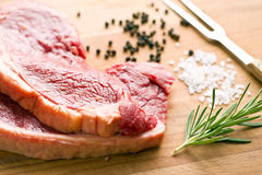 Fresh raw beef. On kitchen table Royalty Free Stock Photos