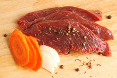 Fresh raw beef meat. With spices Royalty Free Stock Photos
